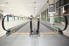 Moving walkways. In a deserted airport terminal Stock Photos