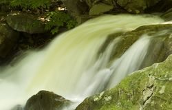 Moving water. Closeup of a water fall royalty free stock images