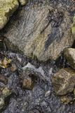 Moving water on rocks Stock Image