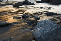 Moving water stream. Moving of water on long exposure with stones Stock Photography
