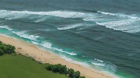 Moving waves on Nunggalan Beach Coastline, Uluwatu, Bali, Indonesia. Moving waves on Nunggalan Beach Coastline, Uluwatu, Bali - Indonesia. One incognizable stock footage