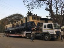 Moving WCAM 3 engine kalyan railway goods station. Moving WCAM 3 engine on trailer truck kalyan railway goods station hajimalang road-Netivali Maharashtra INDIA royalty free stock images