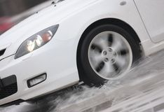 Moving wheel on ice. With water spray Royalty Free Stock Photos