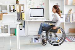 Moving in wheelchair royalty free stock photography