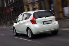 Moving white car Stock Image