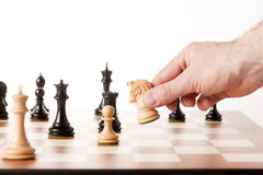 Moving white chess knight on a chessboard Stock Images