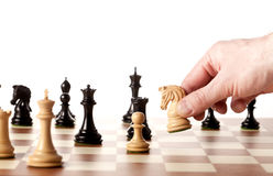 Moving white chess knight on a chessboard Royalty Free Stock Photography