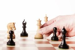 Moving white chess knight on a chessboard Stock Image