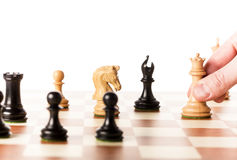 Moving white chess queen on a chessboard Royalty Free Stock Image