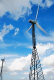 Moving wind turbines and moody sky Royalty Free Stock Photo