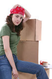Moving Woman. A pretty woman packing boxes getting ready to move Stock Images