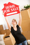 Moving: Woman Holds Up Home Sale Sign Stock Photography