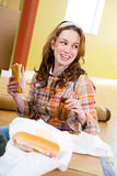 Moving: Woman Takes a Break from Packing with a Snack Stock Photo