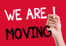 We Are Moving written on the wipe board Royalty Free Stock Image