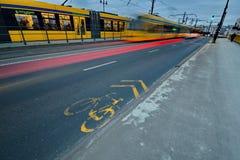 Moving yellow tram Stock Photo