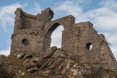 Mow Cop Folly on the Staffordshire/Cheshire border. Mow Cop Castle is a folly of a ruined castle, built in 1754. Primitive Methodism is said by some sources to royalty free stock photography