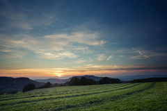 Mowed field in sunset Stock Photos