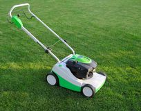Mower is on the lawn Royalty Free Stock Photography