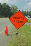 Mowers Ahead. Warning sign of mowers in traffic area ahead, slow down Stock Photos
