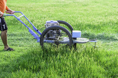 Mowers grass. In football fields Royalty Free Stock Image