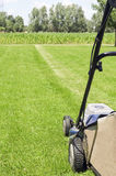Mowing the gras. Image with a lawn mower ready to cut the gras on a sunny day Royalty Free Stock Photo