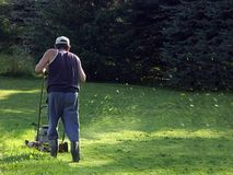 Mowing grass Royalty Free Stock Image