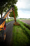 Mowing grass. With machine along roadside Stock Image