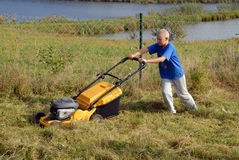 Mowing grass Stock Photo