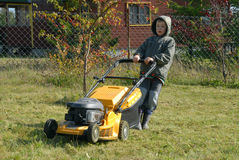 Mowing grass Stock Images