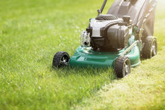 Mowing the grass Stock Images