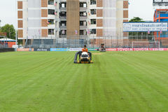 Mowing grass in a football stadium Stock Photography