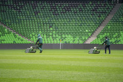 Mowing grass in a football stadium Stock Image