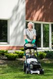 Mowing grass in the garden Royalty Free Stock Photo