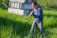 Mowing grass in summer Stock Photography