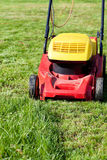 Mowing green grass Stock Photo