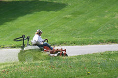 Mowing the hillside Royalty Free Stock Photography