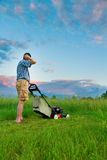 Mowing Job. Man is tasked to mow a field of tall grass Royalty Free Stock Photos