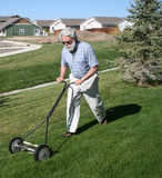 Mowing the Lawn royalty free stock images