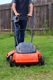 Mowing the Lawn. Close up view of someone mowing the lawn Royalty Free Stock Photography