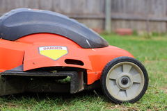 Mowing the Lawn. Close up view of someone mowing the lawn Stock Photos