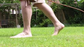 Mowing a lawn. With an electric mower stock footage