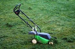 Mowing Lawn With Green  Lawnmower Stock Image