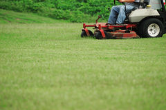 Mowing the lawn. Men working on mowing the lawn Stock Photos