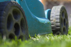 Mowing a lawn Royalty Free Stock Photos