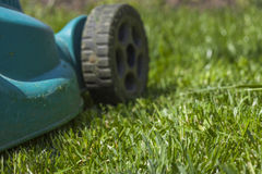 Mowing a lawn Royalty Free Stock Photography
