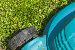 Mowing a lawn Royalty Free Stock Photo