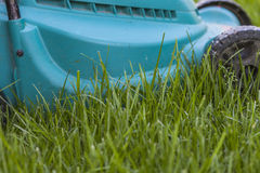 Mowing a lawn Royalty Free Stock Images