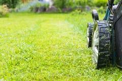 Mowing lawns, Lawn mower on green grass, mower grass equipment, mowing gardener care work tool, close up view, sunny day. Mowing lawns, Lawn mower on green stock photo