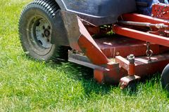 Mowing lawns, Lawn mower on green grass, mower grass equipment, mowing gardener care work tool,. Lawn mower on green grass, mower grass equipment, mowing royalty free stock images