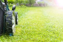 Free Mowing Lawns, Lawn Mower On Green Grass, Mower Grass Equipment, Mowing Gardener Care Work Tool, Close Up View, Sunny Day. Soft Royalty Free Stock Photography - 103480977